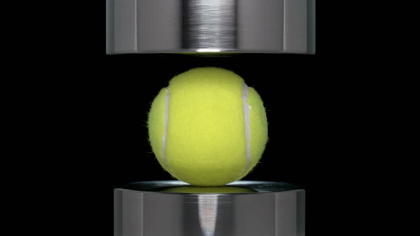 The ball from the big tennis presses hydraulic press, close-up   Shutterstock HD Video #1016294281