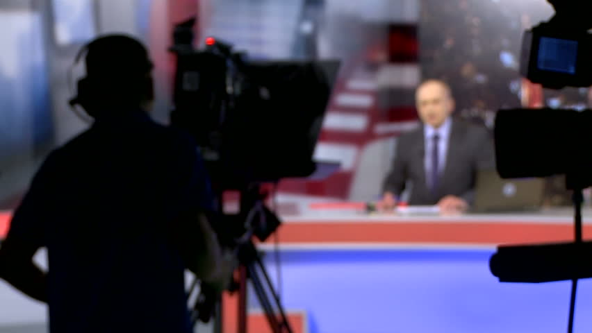 Backstage shooting news in a television studio. News presenter. Royalty-Free Stock Footage #1016311228