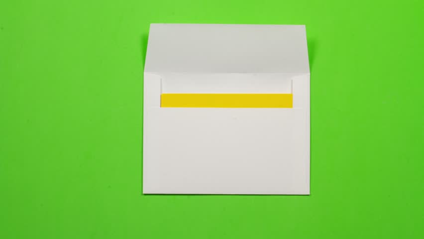 Yellow sheet of paper folds and gets into a white envelope. Then leaves screen on the right. seamless loop. With alpha channel  luma matte to add copy and remove background.