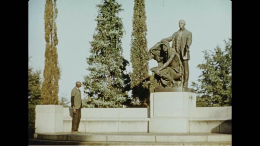 CIRCA 1937 - George Washington Carver visits the sculpture of Booker T. Washington at Tuskegee University.