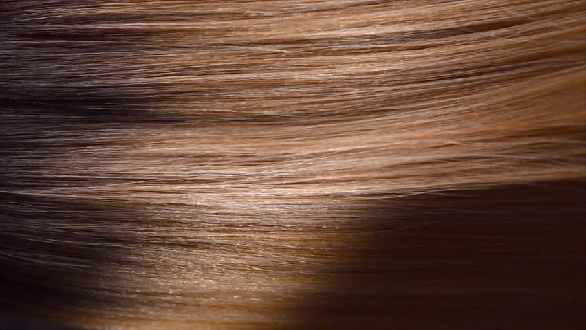 Hair. Beautiful healthy long smooth flowing brown hair close-up texture. Dyed straight hair background, coloring, extensions, cure, treatment concept. Haircare. Slow motion 4K UHD video | Shutterstock HD Video #1016343709