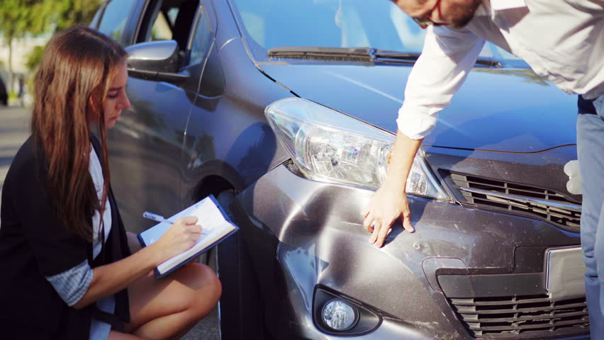 Man explaining to inspector how the car accident happened. Car crash. Broken car. 4K UHD.