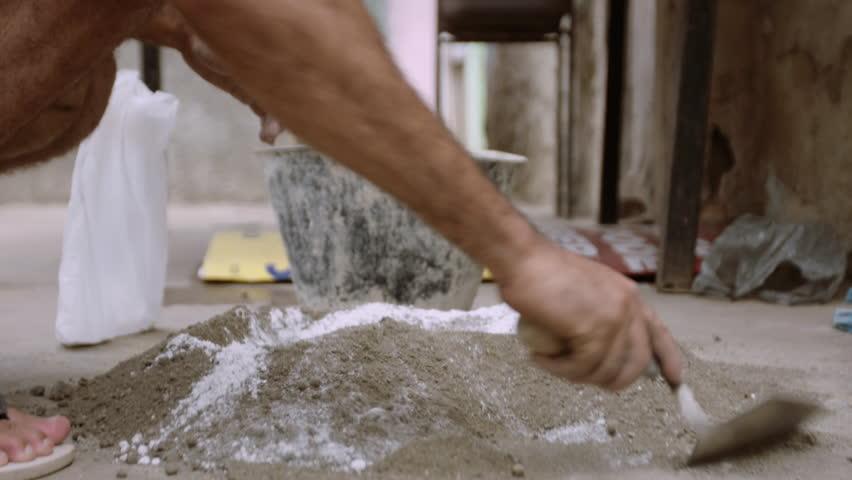 Man Mixing Cement in Street   Shutterstock HD Video #1016355397