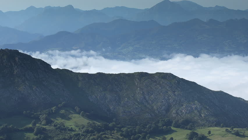 Morning above the clouds in the picos de europa, asturia, spain   Shutterstock HD Video #1016364529