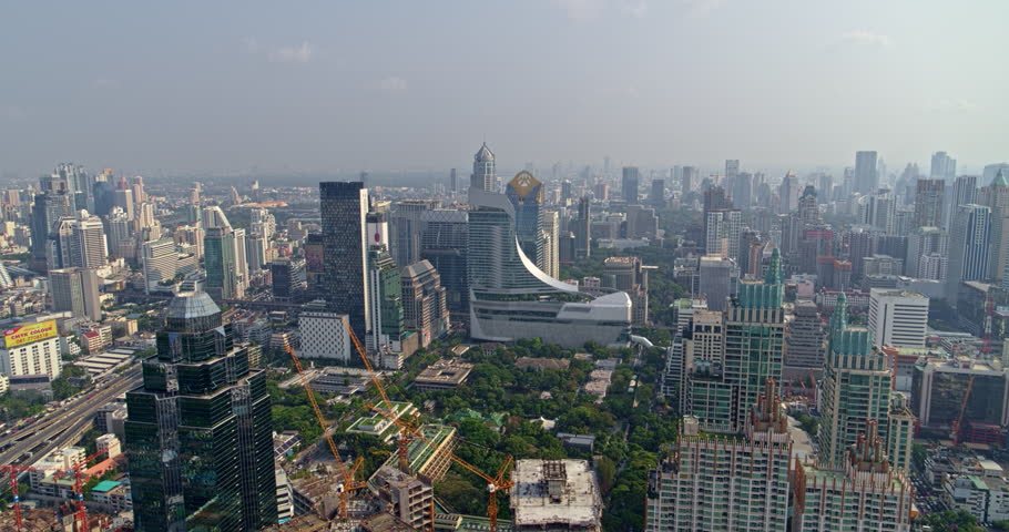 Thailand Bangkok Aerial v158 Birdseye to vertical of cityscape with water view and rooftop detail | Shutterstock HD Video #1016371441