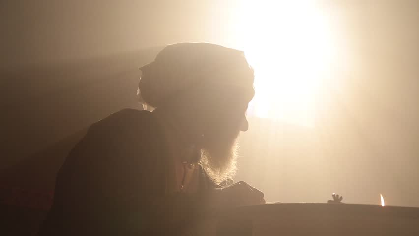 Old islamic muslim scientist working in madrasah room. Old tools, reed pen, ink pot, papirus drawings and book of quran some scenes in dark and foggy enviroment.  | Shutterstock HD Video #1016384578