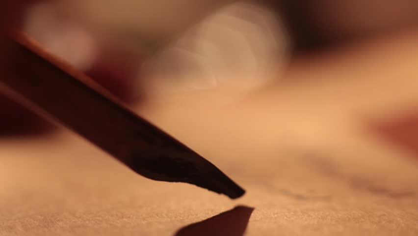 Islamic muslim scientist and his pen. Close up reed pen writing fake arabic letters on papirus | Shutterstock HD Video #1016384587