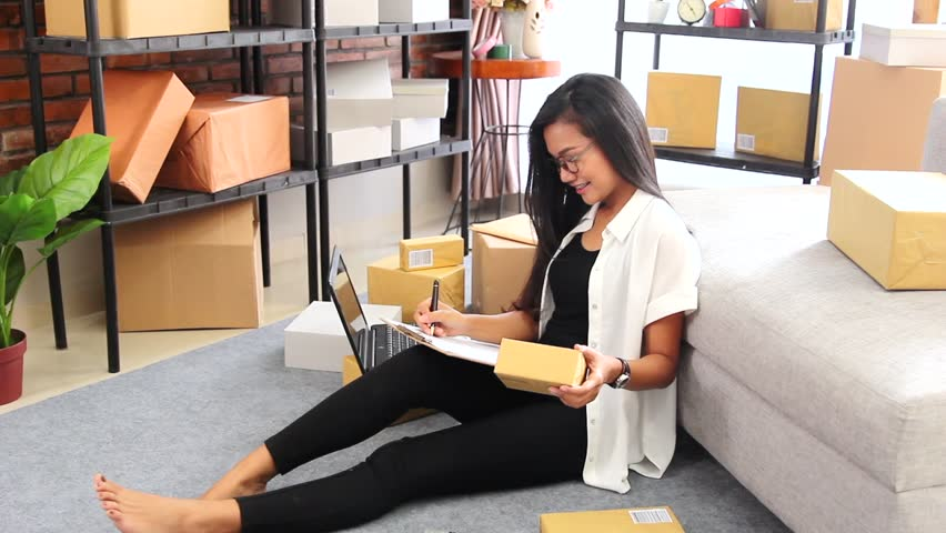 Portrait young woman online seller counting her product ready to be delivered to customer | Shutterstock HD Video #1016386726