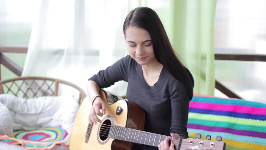 beautifulwoman playing guitar
