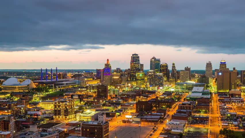 Kansas City, Missouri, USA downtown skyline from dusk to night.