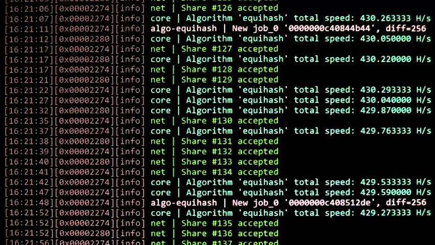 Cryptocurrency mining on a computer screen. The algorithm of the computer program on the monitor. Execution of the program code for the mining program. Pop-up lines of a computer program.