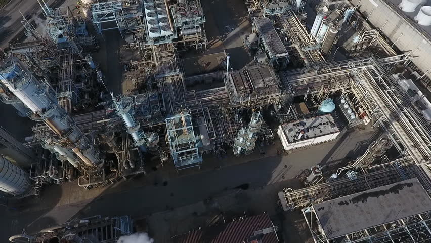 Aerial drone over power plant tilt up to see city streets | Shutterstock HD Video #1016432746