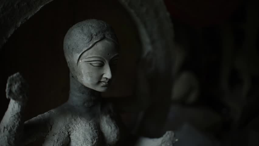 An idol of Indian Goddess Maa Laxmi is being made with clay in India for the preparation of upcoming Hindu festival Durga Puja | Shutterstock HD Video #1016440069