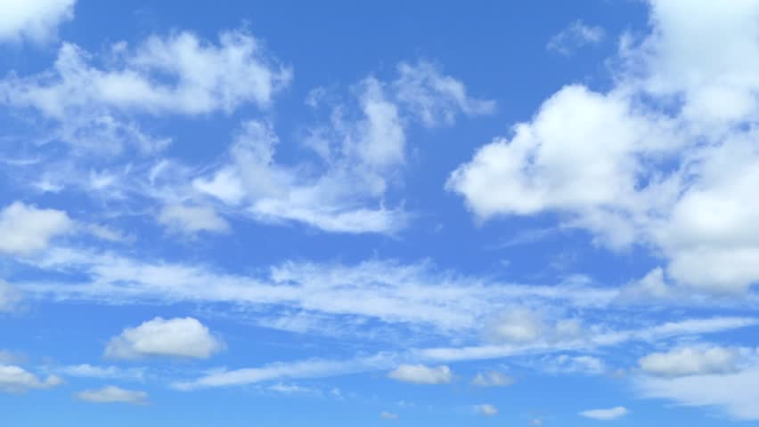 Time lapse clouds moving quickly amid blue skies.  #1016451835