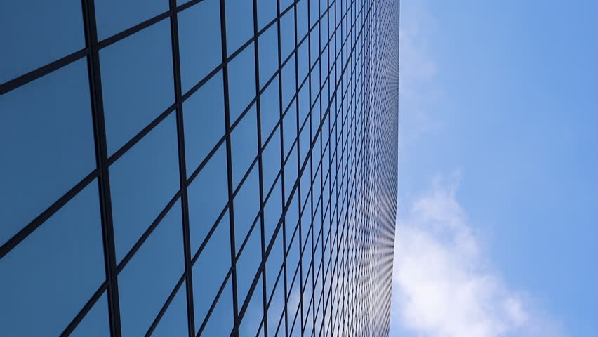 Clouds reflected of glass sky scrapper in Boston, blue sky scrapper in Boston, time lapse of clouds in Boston with buildings and reflections.