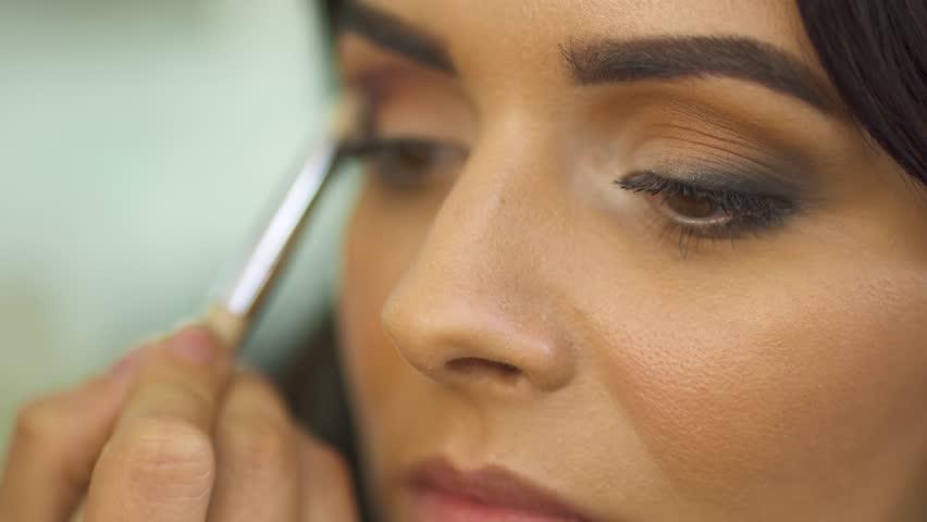 Beautiful young girl in a beauty salon   Shutterstock HD Video #1016467738