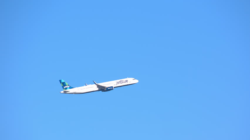 NEW YORK - 2018: JetBlue Airways Airbus A321-200 Commercial Jet Airplane Flying in a Clear Blue Sky after Taking Off from JFK International Airport