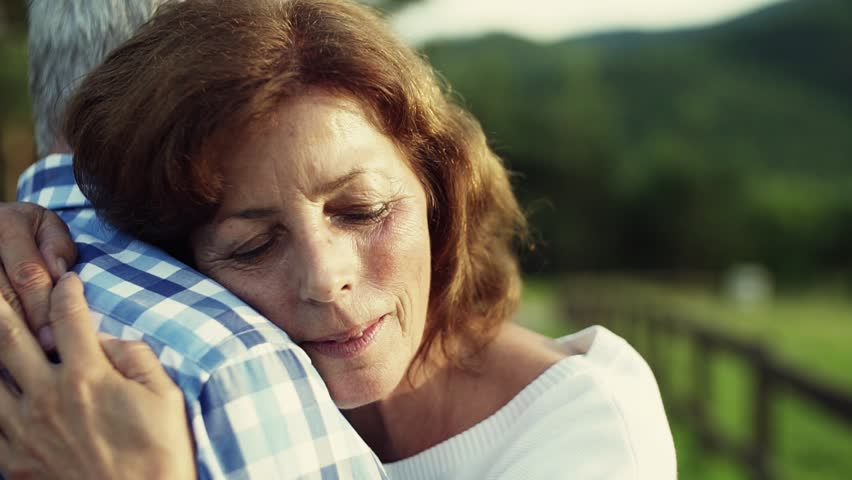 A close-up of senior couple in love standing outdoors in nature, hugging. #1016517124
