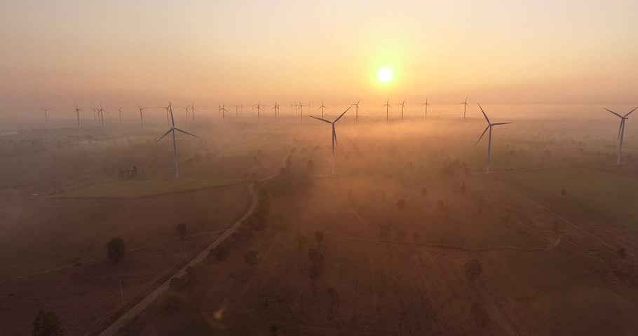 Aerial view of Wind turbines Energy Production- 4k aerial shot on sunrise. 4k drone footage turbines at sunrise with clouds. Sustainable development, environment friendly, renewable energy concept. | Shutterstock HD Video #1016538406