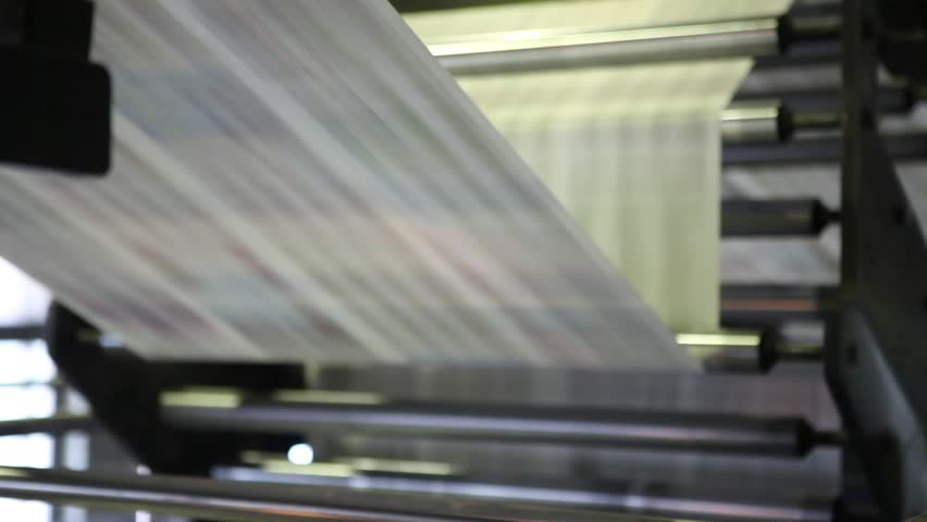 Video clip from the printing factory. Kilometers of newspapers. Printing machines in operation. Royalty-Free Stock Footage #1016553007