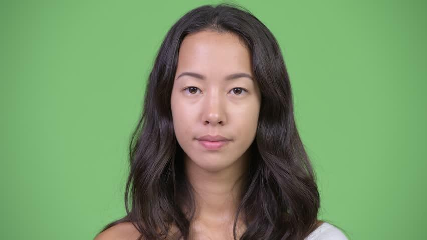 Young beautiful multi-ethnic woman looking shocked | Shutterstock HD Video #1016555407