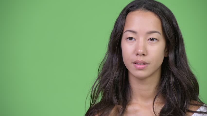 Head shot of young happy beautiful multi-ethnic woman having an interview | Shutterstock HD Video #1016555461