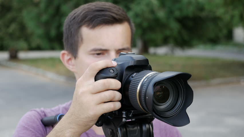 filmmaker takes video with DSLR Camera #1016567878