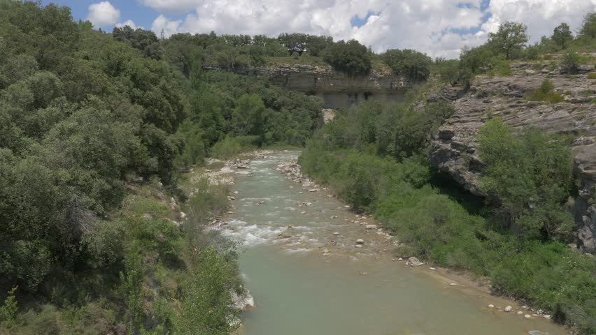 River At Barranco De Ramillar, Pyrenees, Spain - native version. Native 4:2:2, 10 Bit Material, straight out of the cam, watch also for a graded and stabilized version.   Shutterstock HD Video #1016583475