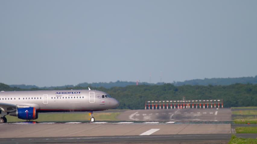 DUSSELDORF, GERMANY - JULY 22, 2017: Aeroflot Airbus 321 VP-BFX taxiing after landing. Dusseldorf Airport, Germany