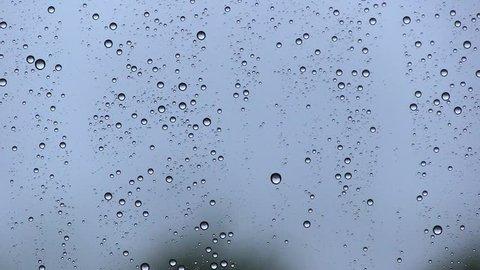 WATER DROPS IN WINDOW WHILE RAINING