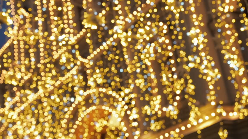 Bright Christmas Street Illumination. The City is Decorated for the Christmastide Holiday. New Year Lights Decorating Shimmering bokeh | Shutterstock HD Video #1016600122