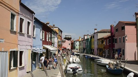 Venice Lagoon, Island of Burano. Italy, August 2018. The canals of S.Mauro and Pontiello foundations cross the heart of Burano. Along these are the colorful houses.
