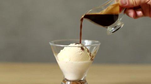 Pouring espresso on the ice cream