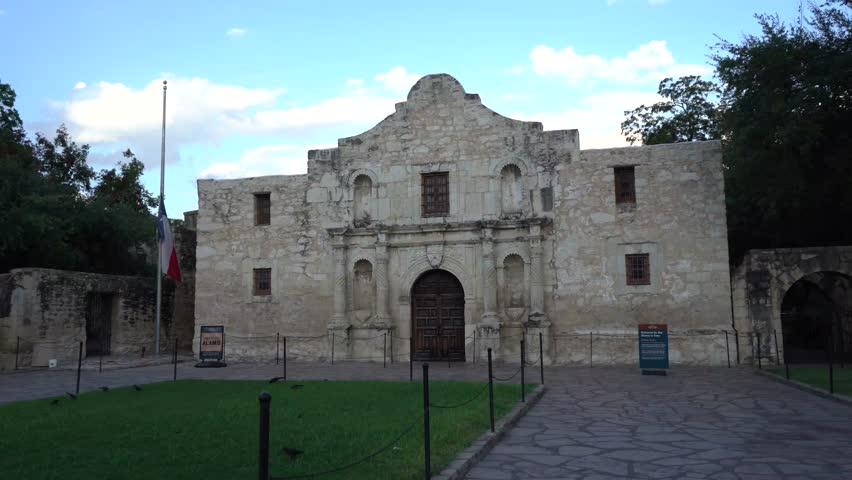 The Historic Alamo at Dusk with Texas Flag Flying at Half Mast Panning Video