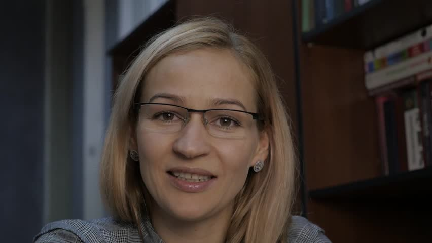 female tutor having video conferencing with apprentice. Woman in front of camera, online office at home. Royalty-Free Stock Footage #1016651905