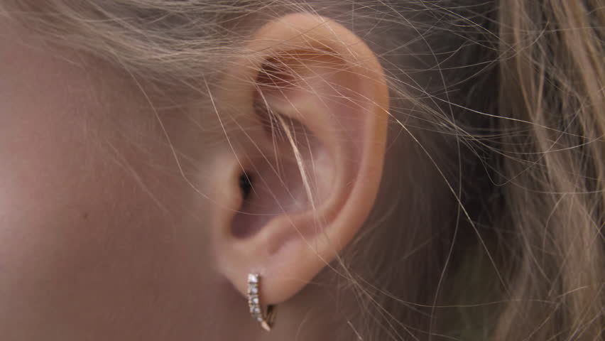 Female ear with earring close up. Ear of woman blonde with decorative piercing | Shutterstock HD Video #1016652949