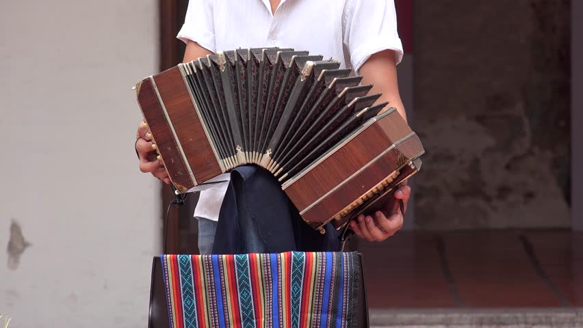 Playing the bandoneon, Argentina.