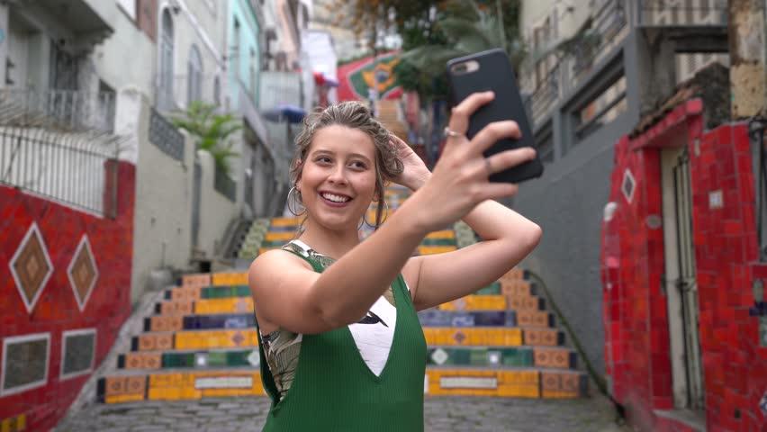 Happy beauty young brazilian woman taking a selfie photo in Rio de Janeiro, Brazil  | Shutterstock HD Video #1016676136
