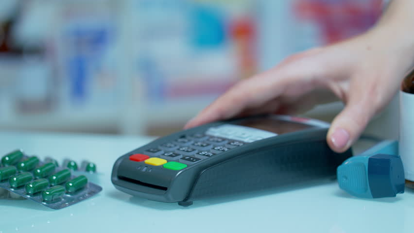 Nfc payment at drugstore. Close up of male hand using mobile payment at nfc terminal. Customer payment drugs with nfc technology. Medical payment with mobile pay | Shutterstock HD Video #1016726959