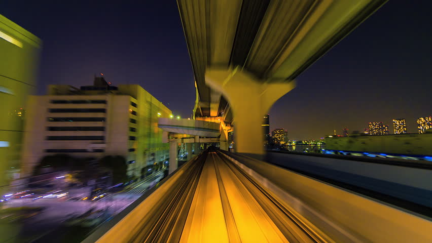 4K.Time lapse automatic train fast speed at Tokyo city of Japan    Shutterstock HD Video #1016733715