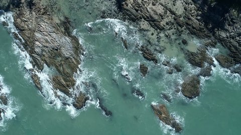 Aerial view drone shot of seascape scenic wave crashing on the rocks
