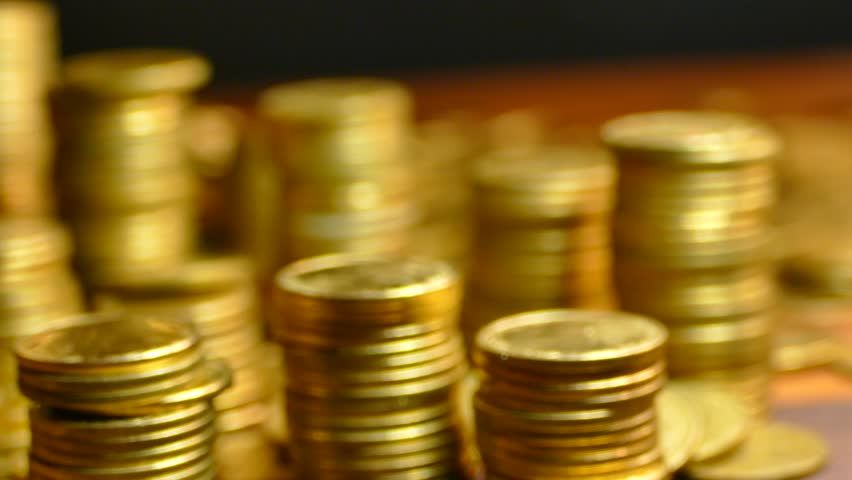 Much money. Earned capital. Wealth in the bank. The depository of gold coins. Treasure hoard. Pension Fund. Millionaire or billionaire. The acquired status. Royalty-Free Stock Footage #1016752708