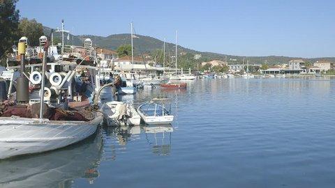 Zakynthos, Ionian Islands. / Greece - 07 08 2018: Greek island with little rowing boat and fishing boat