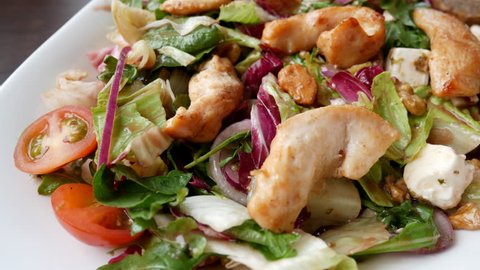 Eating healthy chicken salad close up