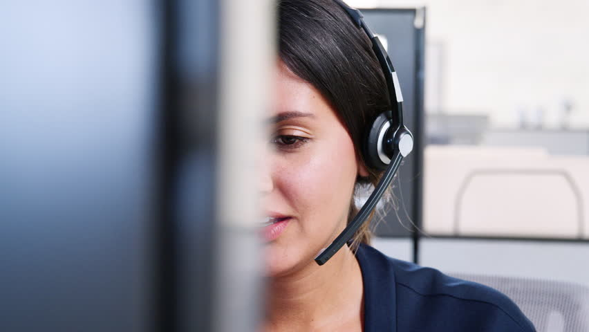 Young mixed race woman working in call centre Royalty-Free Stock Footage #1016815177