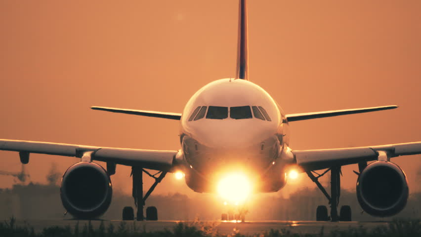 Turbo airplane is taxiing on the taxiway after landing at sunset | Shutterstock HD Video #1016820802