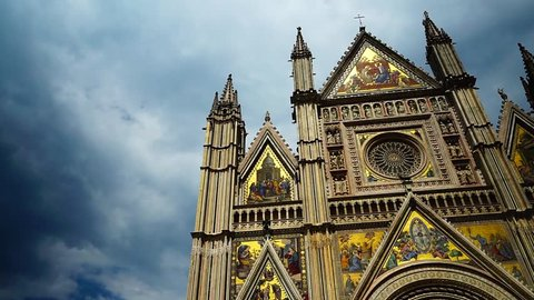 Facade of the cathedral of Orvieto with the famous golden decorations