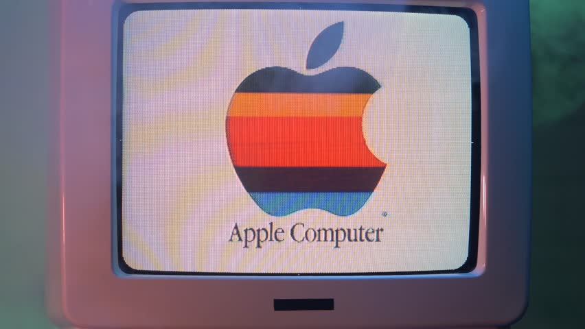MONTREAL, CANADA - September 2018 : Old Apple Computer logo on a vintage tube display monitor with fog around. 80s 90s style clip of a Mac computer