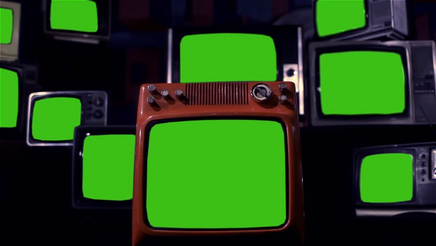 Pile of Old Television Sets with Green Screens. Dark Tone. Zoom Out. | Shutterstock HD Video #1016833672