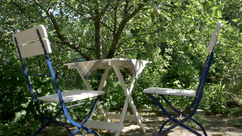 Table under appletree in summer